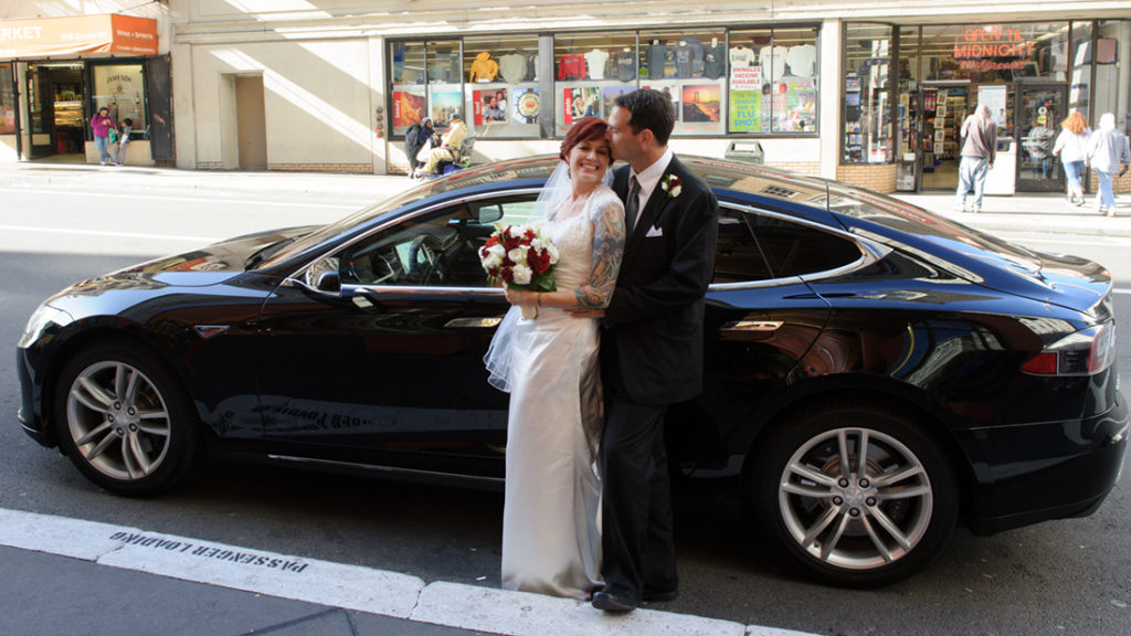 Bride and Groom with Tesla in San Francisco