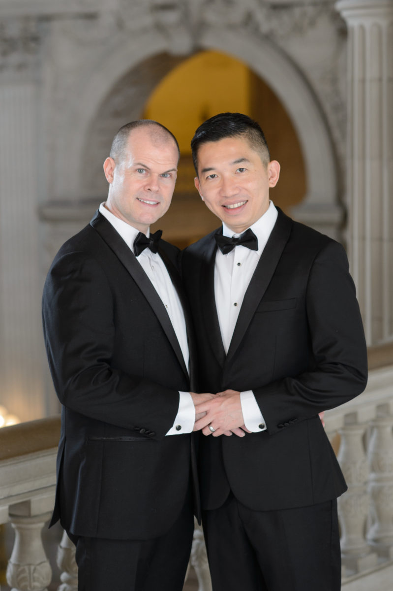 Same-Sex Grooms posing with the Rotunda in the background