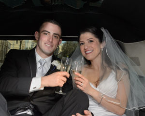 Bride and groom toasting in the Limo on the way to the Marina District in San Francisco