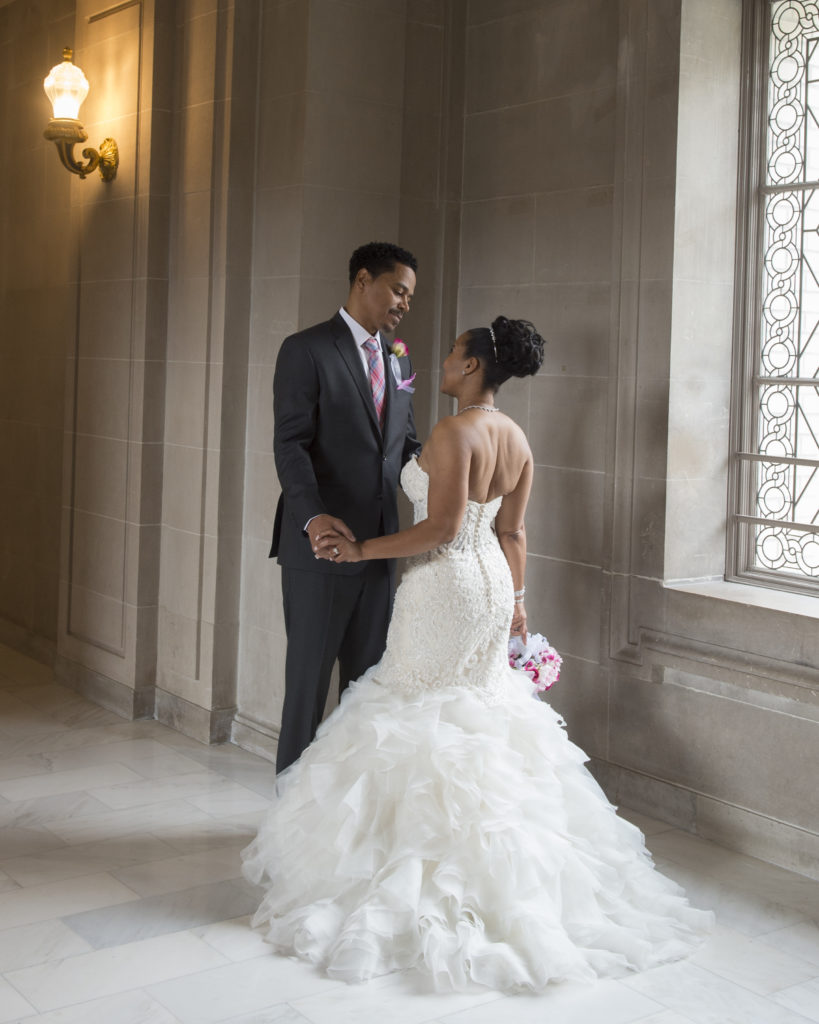 Elegant pose at SF City Hall done by a professional wedding photographer