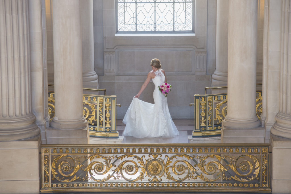 City Hall bride checks her wedding gown
