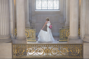 City Hall bride checks her wedding gown