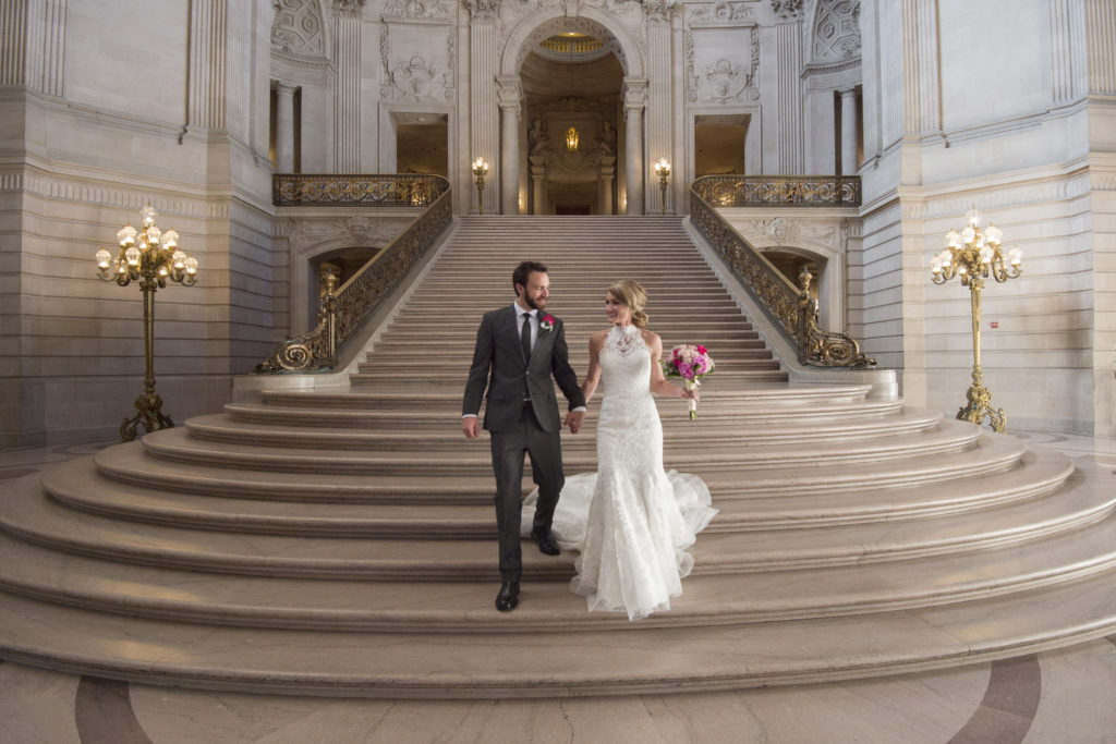 Bride and Groom walking down the Grand Staircase