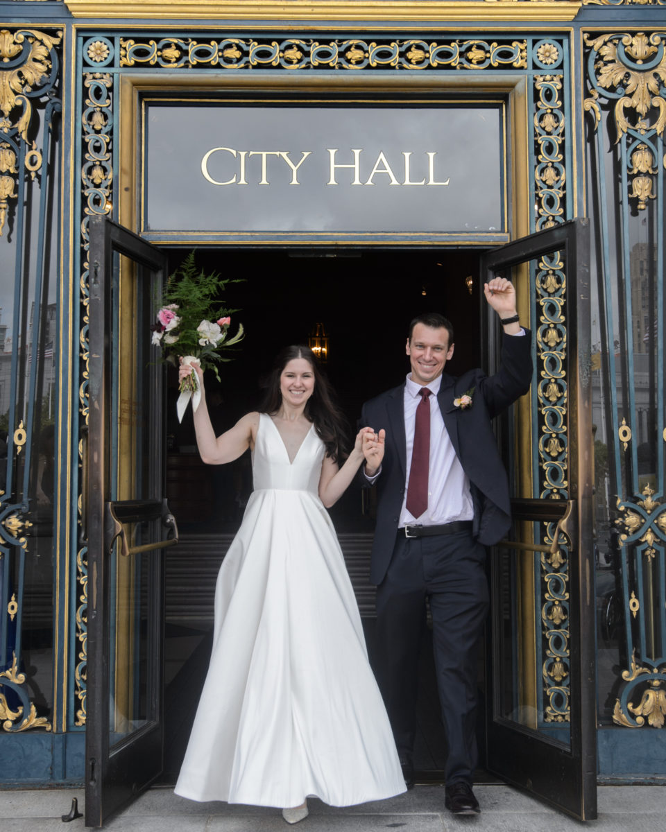 Newlyweds leaving SF City Hall Happy