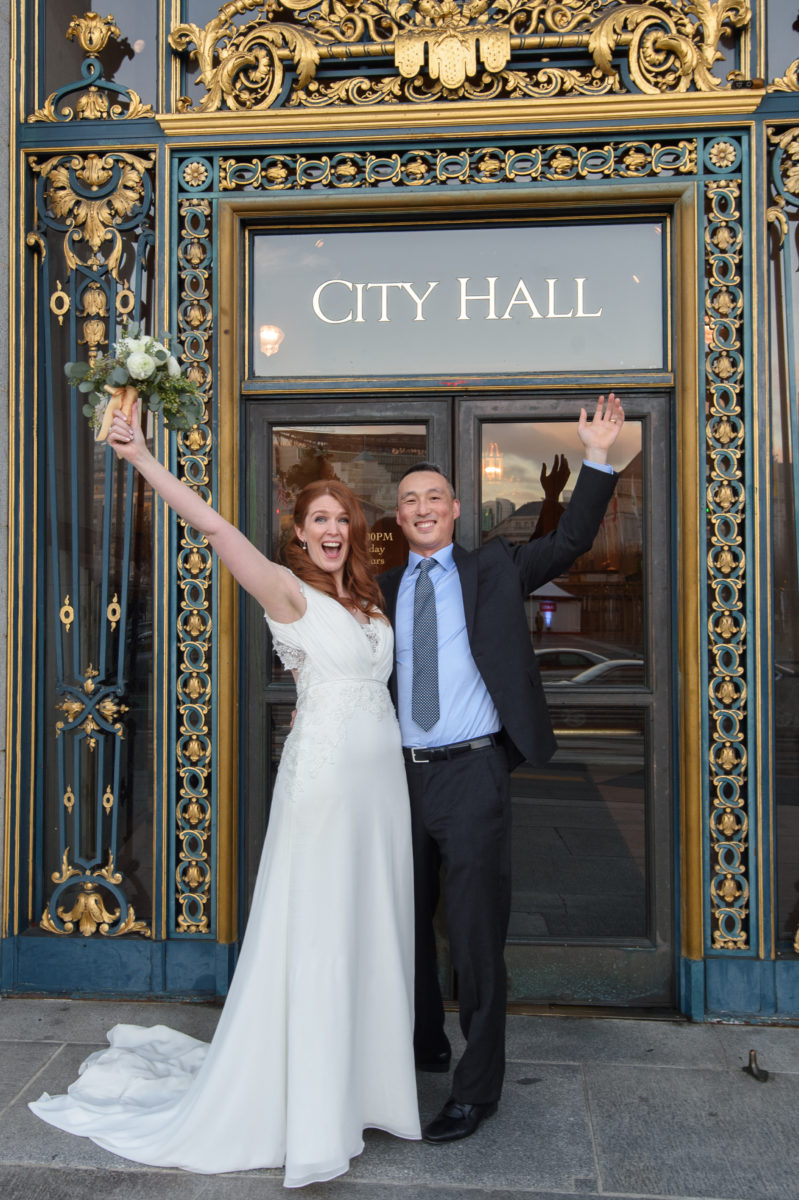 San Francisco City Hall Entrance with happy newlyweds