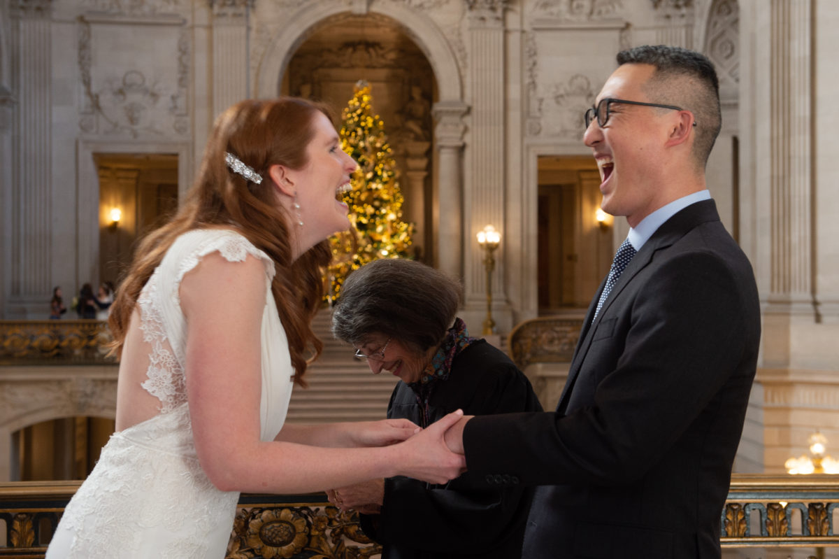 Having fun during their civil ceremony at SF city hall
