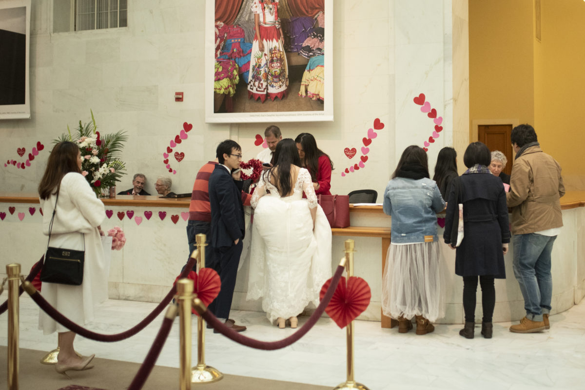 Multiple brides waiting to get married at SF City Hall
