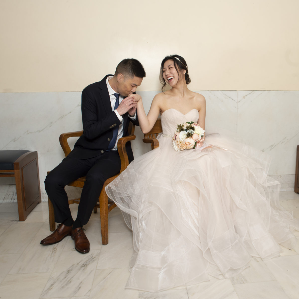 Bride and Groom waiting at the County Clerks office at city hall
