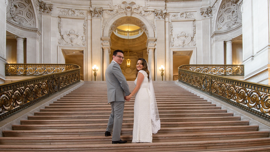 Bride and Groom looking back from the Grand Staircase at San Francisco city hall